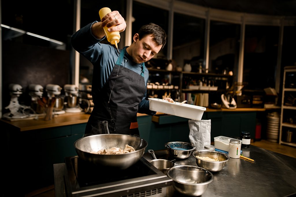 chef cooking with Hedgehog mushrooms